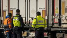 Border Force officials talk to a lorry driver at the Daera site near Belfast Harbour (Liam McBurney/PA)