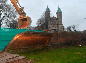 A peace wall at the top of the Crumlin Road in Belfast opposite Holy Cross Church in 2016 being demolished