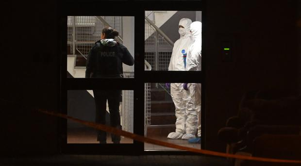 Forensic experts at the scene in Kinnaird Close