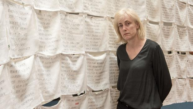 Lycia Trouton, whose exhibition of Irish linen embroidered with the names of all the Troubles victims is in Derry's Central Library