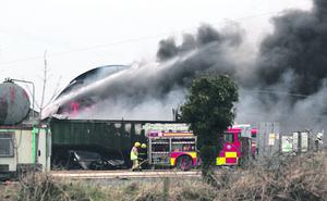 Fire fighters tackle a blaze an an industrial factory