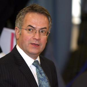 Alex Attwood said 11 new authorities will have powers over planning, roads, regeneration and housing from 2015