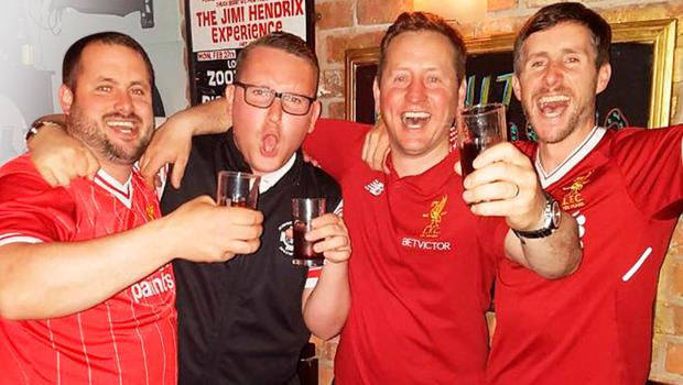 Liverpool fans Jude, Joe and Sean McMahon (in red shirts) with pal Colin Dryden