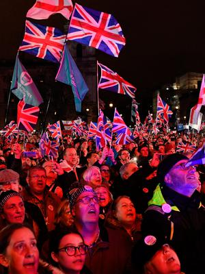 Brexit supporters celebrate at Parliament Square