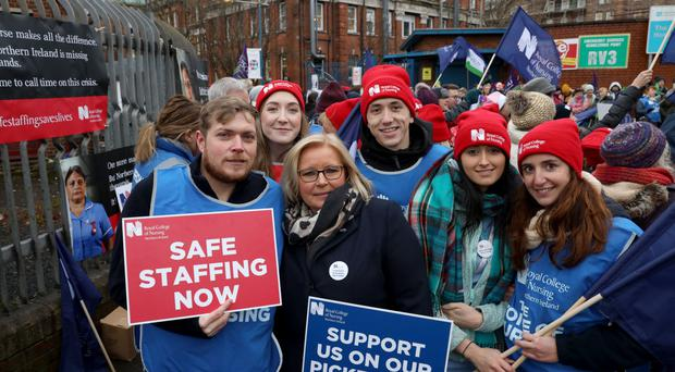 Pat Cullen (third left), director of the RCN in NI, with nurses outside the Royal Victoria Hospital