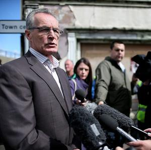Sinn Fein's Gerry Kelly speaks to the media in Castlederg, County Tyrone ahead of the controversial parade.