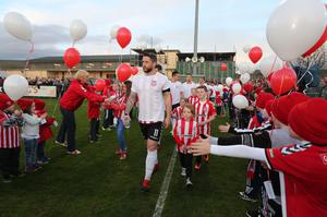 Derry City players and fans pay their respects to the late club captain Ryan McBride at Maginn Park