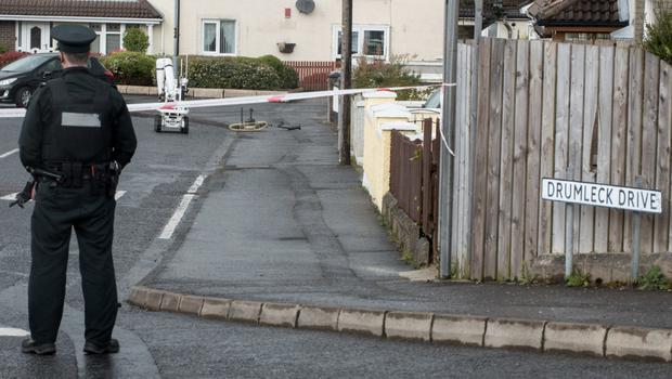 Police at the scene of a suspected pipe bomb in Drumleck Drive