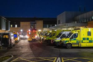 Ambulances at the entrance to the emergency department with a number of the vehicles with patients awaiting to be admitted at Antrim Area Hospital (Liam McBurney/PA)