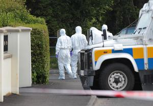 Police at the scene after a bomb was found under the car of a PSNI officer in Eglinton in 2015