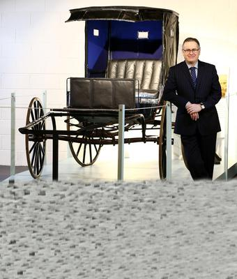 Peter Kelly, head of operations at the Ulster American Folk Park, with the buggy