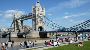 Bridge over untroubled water: People take in the warm weather in Potters Field, near Tower Bridge, as the bank holiday weekend approaches