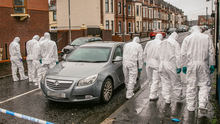 Investigation: Police search the site of the shooting in north Belfast on Wednesday