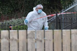 Forensic experts at the murder scene in Ballycastle
