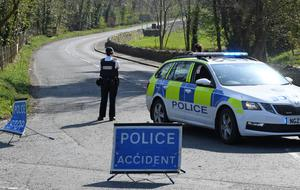 Police close off Spa Road outside Ballynahinch yesterday after accident