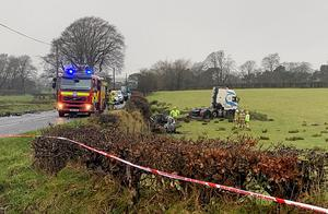 Emergency services at the scene of the fatal crash on the Ballylagan Road near Straid, Ballyclare