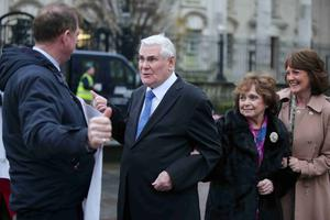 Pastor James McConnell arrives at Belfast Magistrates Court yesterday with his wife Margaret and daughter Linda