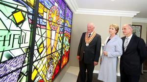 Mary McAleese with husband Martin and Orange Order Grand Master Edward Stevenson (left) viewing the memorial window at the opening of the Museum of Orange Heritage