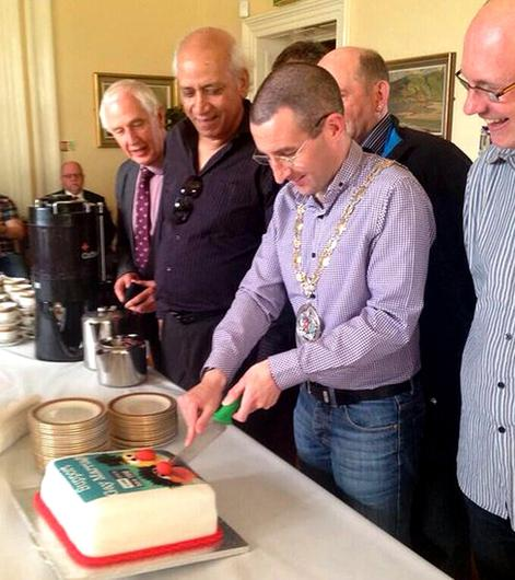Mayor Andrew Muir cutting a Sesame Street Bert and Ernie 'Support Gay Marriage' cake