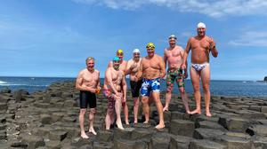 The Oa Giants – BIll Donnelly, Keith Garry, John McElroy, Dominic Mudge, Colin Lindsay and Chris Judge after becoming the first to complete the challenging swim from the Isle of Islay in Scotland to the Giant's Causeway in Northern Ireland (Karen Brown/PA)