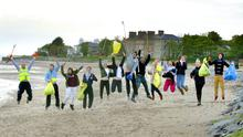 Volunteers from Danske Bank jump for joy at Seapark, Holywood, for the launch of the Big Spring Clean 2015 yesterday. A free clean-up kit is available by registering at www.liveherelovehere.org
