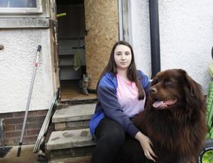 Teenager Bryanne Nelson with Olaf, one of the Newfoundland dogs that woke up her mother during an arson attack