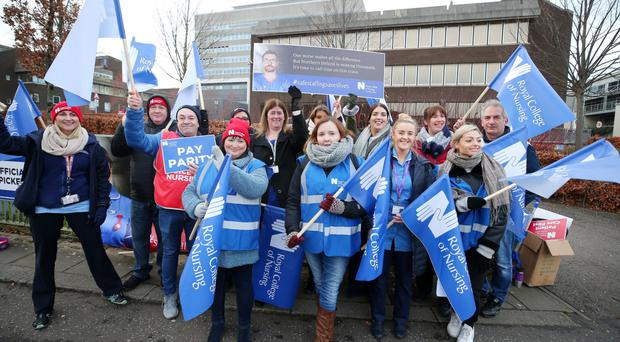 Nurses and health service workers pictured on strike outside the Belfast City Hospital in Belfast as ongoing industrial against continues across Northern Ireland regarding ongoing issues in the NHS.
