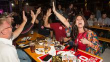 Cheers: Dana Sherrod (right) celebrates with friends while watching results on TV at an election day party in New Braunfels, Texas