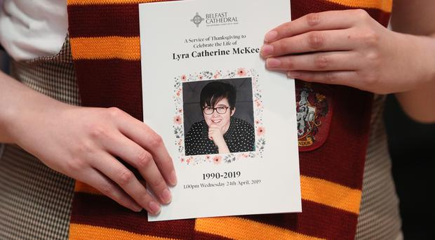 A mourner wearing a Gryffindor scarf holds an order of service as she arrives for the funeral of murdered journalist Lyra McKee (Brain Lawless/PA)