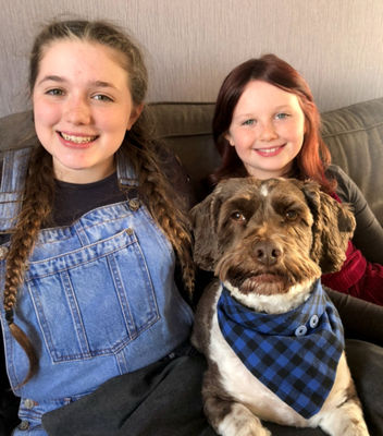 Reelan-Rose Nelson and sister Owenea with five-year-old champion dog Sonny