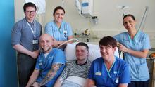 Surfer Matthew Bryce in the Ulster Hospital with Dr Padraig Headley, consultant, staff nurses Aaron Sturdy and Laura Button, sister Rhonda Marks and staff nurse Julie Hunter
