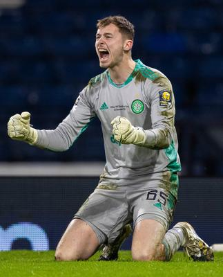 Hero: Celtic's Conor Hazard celebrates after making a crucial penalty save in the Scottish Cup final