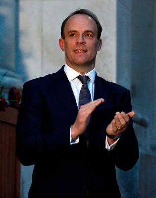 Foreign Secretary Dominic Raab clapping outside the Foreign and Commonwealth Office in London to salute local heroes