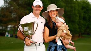 Victory: Rory McIlroy, wife Erica and daughter Poppy with the trophy. Credit: Getty