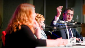 Gavin Robinson aims a shot at Naomi Long as the two square off at the east Belfast hustings last night