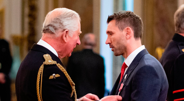 Gareth McAuley is made an MBE by the Prince of Wales at Buckingham Palace yesterday