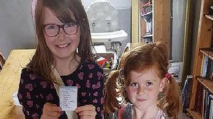 Grace Elizabeth, left, and Kara McKinney are believed to be with their father (Police Scotland/PA)