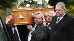 Funeral: Family and friends carry David Cook's coffin into Roselawn Crematorium