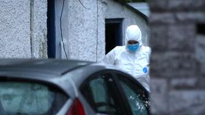 Police probe: A forensic expert at the scene of the shooting on Wednesday. Credit: Declan Roughan