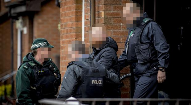 Police carry out searches in the Shankill area of Belfast yesterday