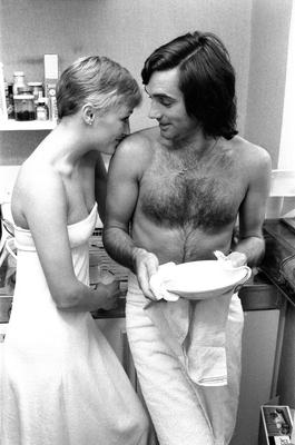 George Best larks around in his kitchen with Angie in 1976
