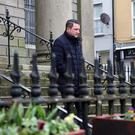 Sinn Fein's John Finucane outside court