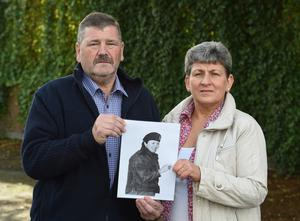 David and Irene Kerrigan with a photograph of his sister, Heather, who was murdered in 1984