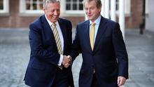 First Minister Peter Robinson greets Taoiseach Enda Kenny at the British-Irish Council Summit at Dublin Castle yesterday