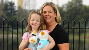 Support: Fay McEvoy (6) and mum Nuala with the duck bringing comfort to children with cancer across Northern Ireland. Credit: Phil Smyth