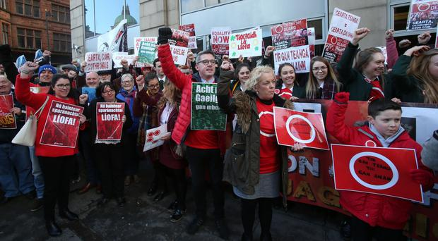 A network of Irish language activists protest against cuts to Irish language bursaries (Niall Carson/PA)