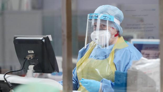 A member of the intensive care team treats Covid-19 patients at Craigavon Area Hospital in Co Armagh (Niall Carson/PA)