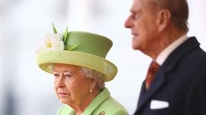The Queen wore an ensemble by Angela Kelly - a green cashmere coat, a silk crepe dress in shades of apple green, grey and gold lame, and a matching hat