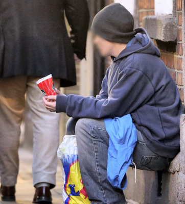 A man begs for money on the street