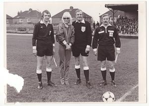 Angie Best with the referees